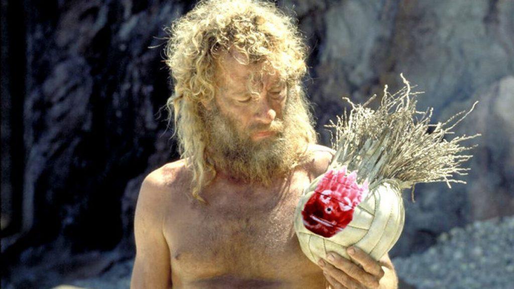 Tom Hanks sujetando a Wilson en la película «Náufrago».